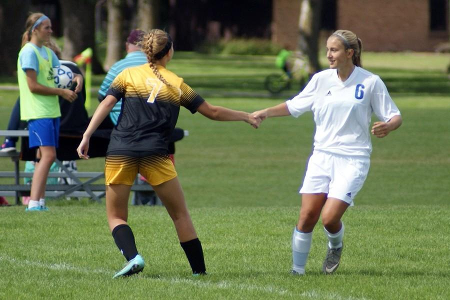 Senior Becca Sedivy greets fellow Burnsville player