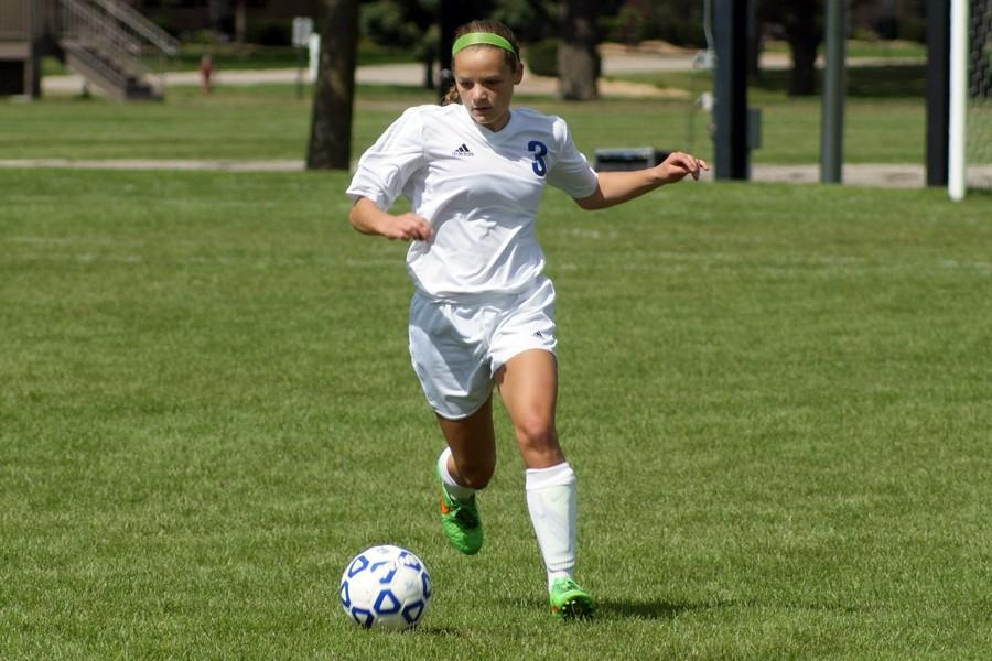 Sophomore Sophie Amundson takes the ball across midfield