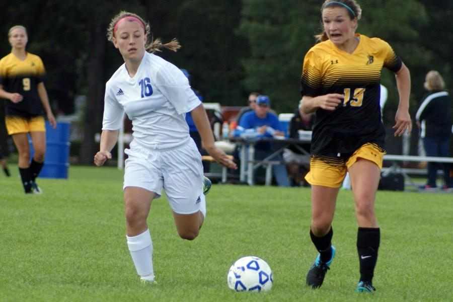 Sophomore Bria Wachowiak defends the ball from Burnsville player