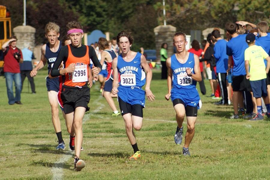 Sophomore Evan Steiger and Freshman Caedon McCartney running the home stretch