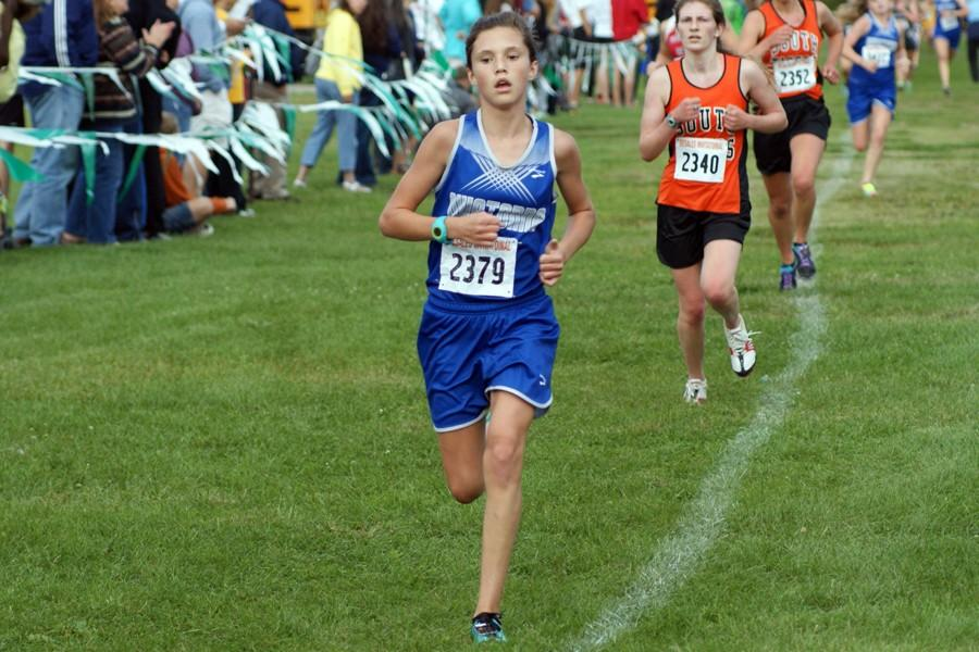 8th Grader Grace Randall finishes up her race