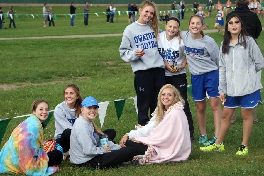 The girls JV team cheers on the varsity sqaud