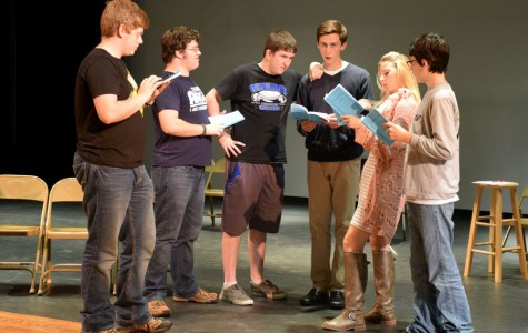 Main cast members read through their scripts after school during rehearsal.