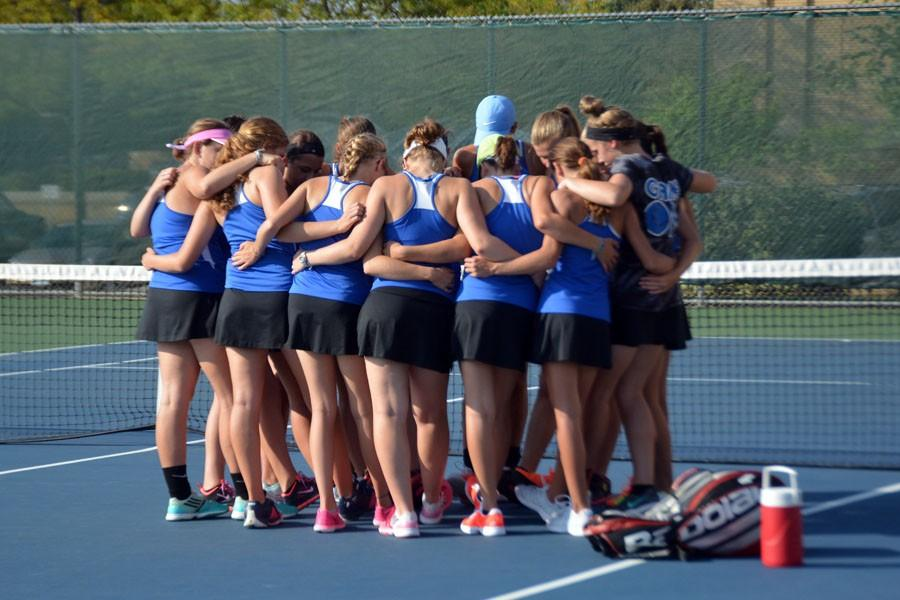 The team huddle before the matches start.