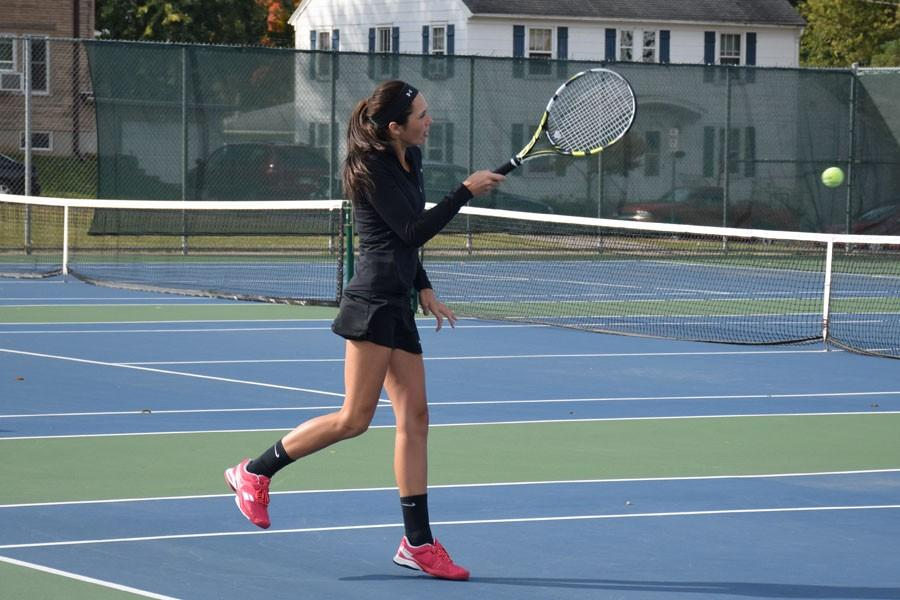Junior Gabi Deml hitting the ball to her opponent