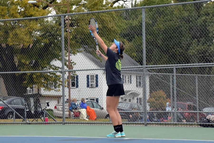 Junior Katie Segler serving the ball