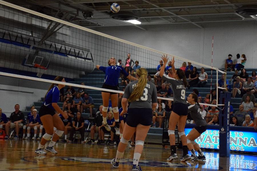 Sophomore Sydney Schultz spiking the ball
