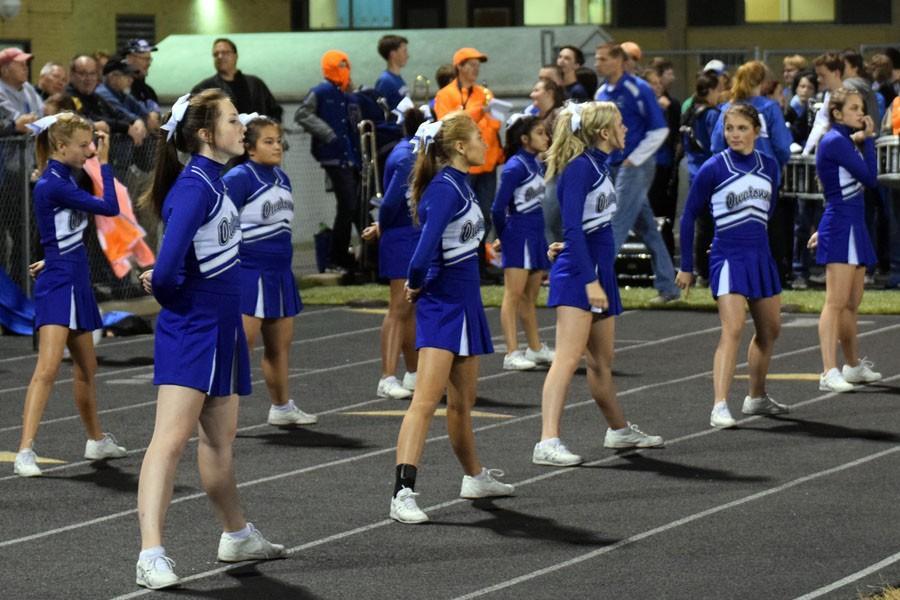 Owatonna Cheerleaders cheering on the team