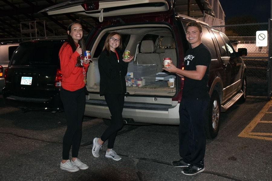 Junior students Andrew Wall, Grace Simon and Samantha Mundale collecting food for the food shelf