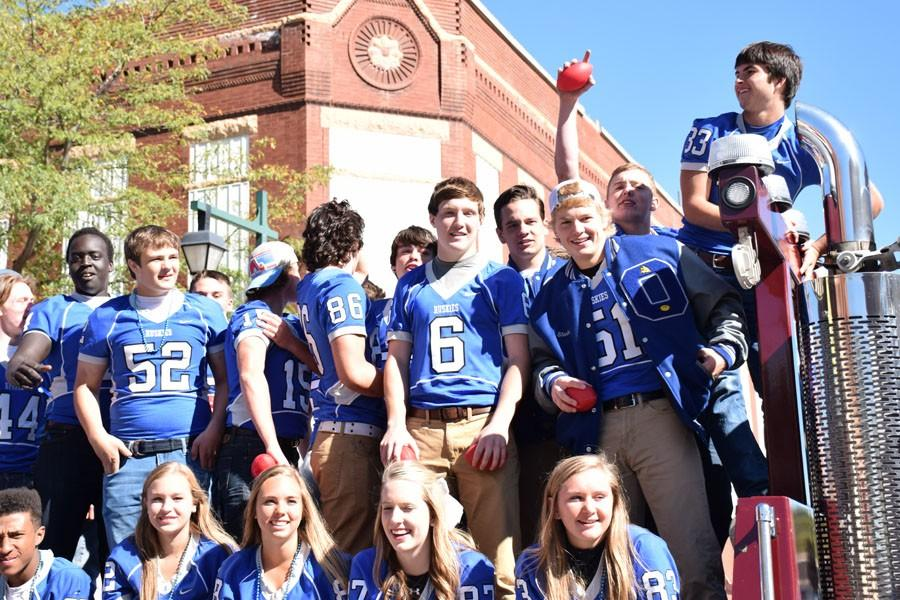 Owatonna football team on their float