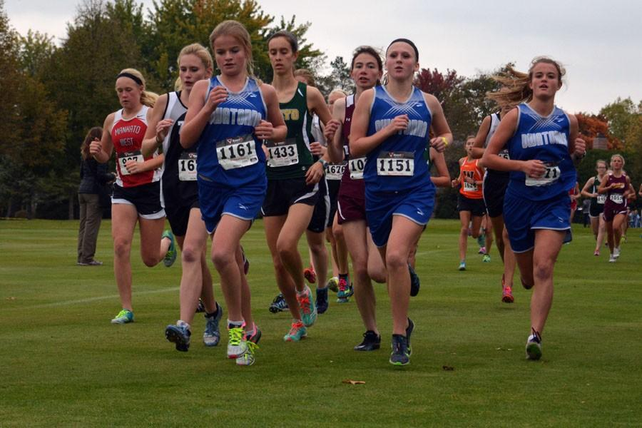Owatonna Girls Cross Country running in their meet