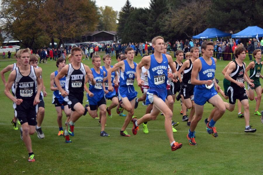 Owatonna Boy's Cross Country running in their meet