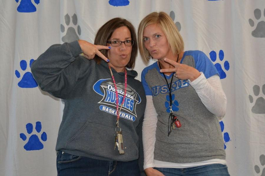 Teachers Mrs. Lori Peglow and Mrs. Beth Fink show their school spirit at the Magnet Photo Booth