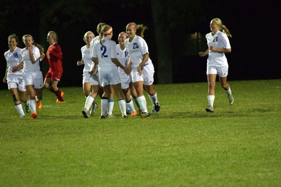 Owatonna+Girls+Soccer+celebrates+after+scoring+a+goal