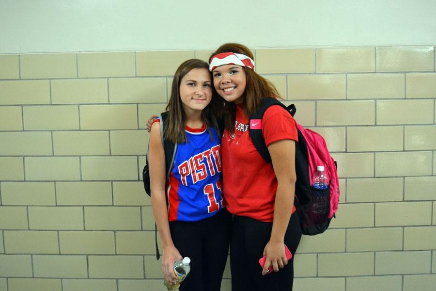 Freshmen Emily Beckmann and Jasmyn Harris show their school spirit