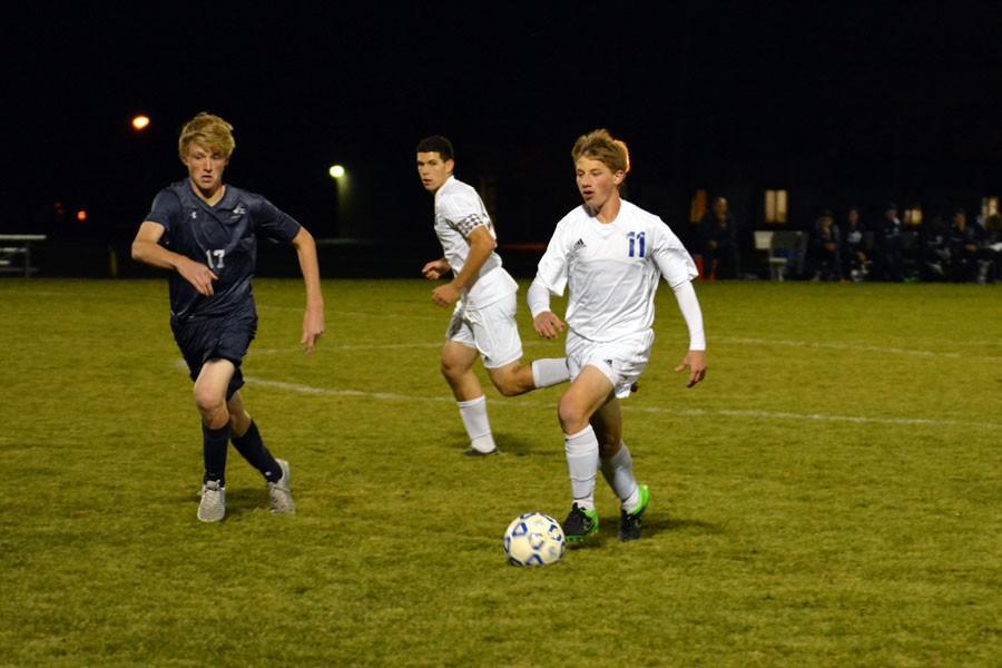 Junior Daniel Keller running with the ball