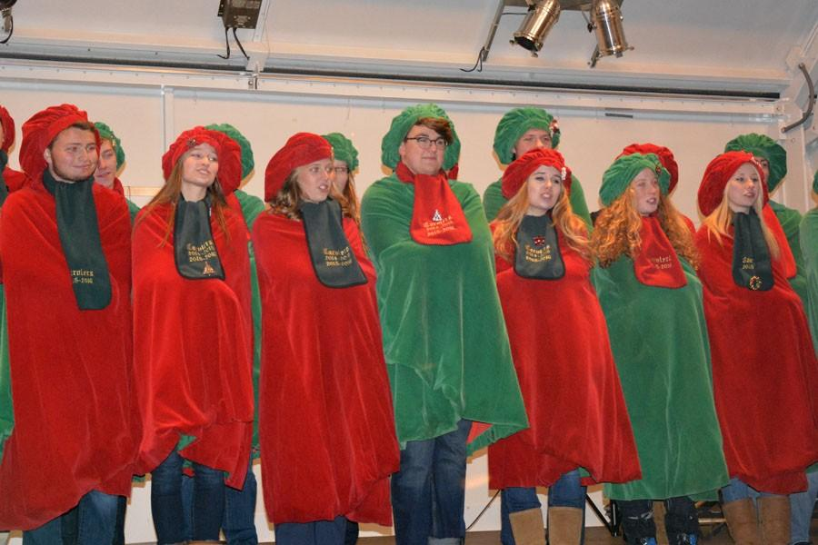 Owatonna High School Carolers sing to the crowd in Central Park