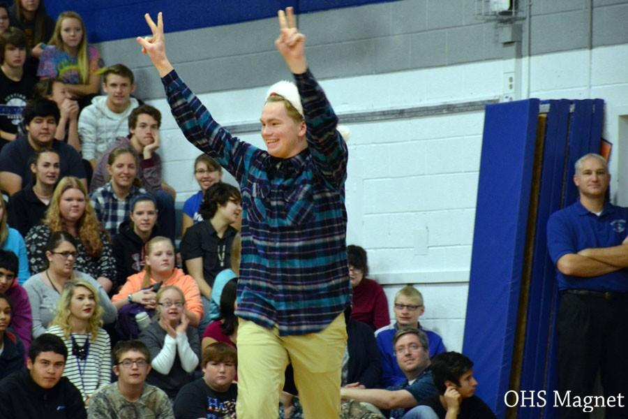 Junior Logan Ringhofer performing a skit during the pepfest