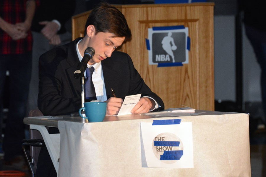 Nick Hagen writing thank you notes for a skit