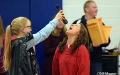 Senior Maria Golberg singing during a skit during the pepfest