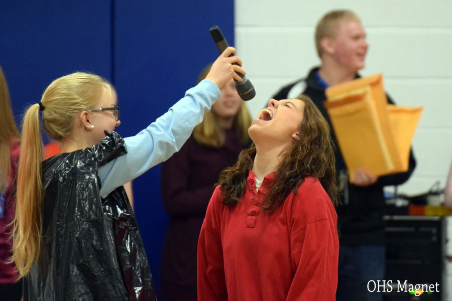 Senior Maria Golberg singing during a skit during the pepfest