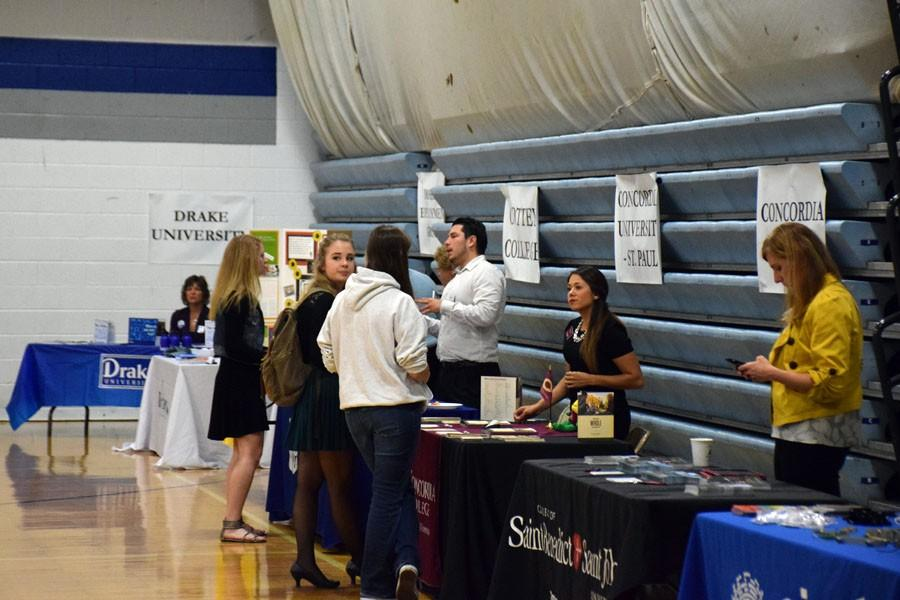 Students talking to colleges during the College Fair