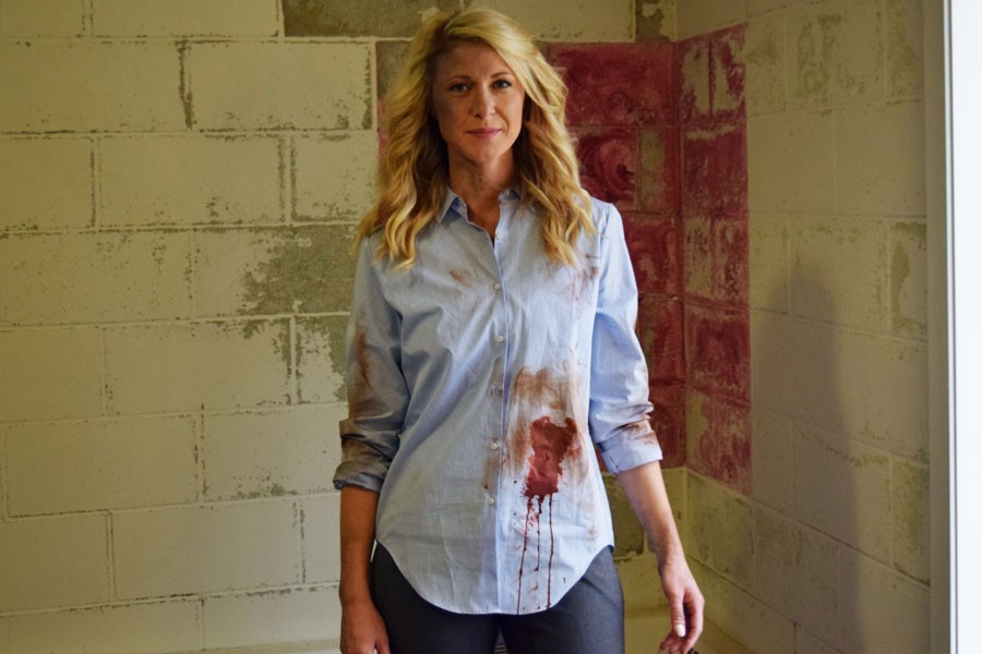 Actress Amber Rhodes poses on the set of Zombies being filmed in and around Owatonna