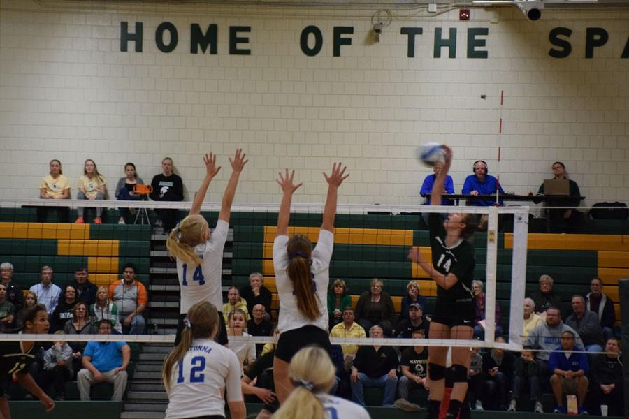 Senior co-captain Elise Oppegard and junior Lexi Langeland go up for a block against Mayo