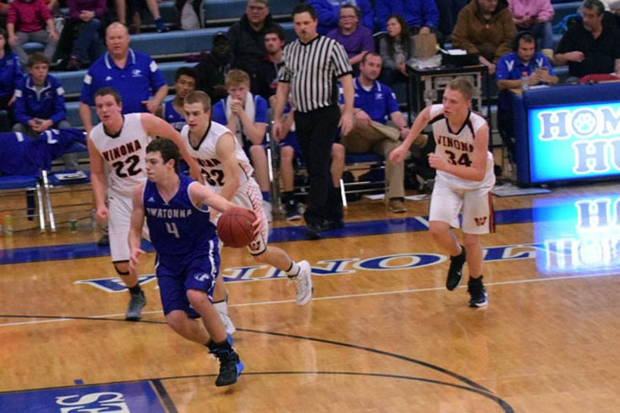 Sophomore Alex Raichle drives the lane against Winona defenders