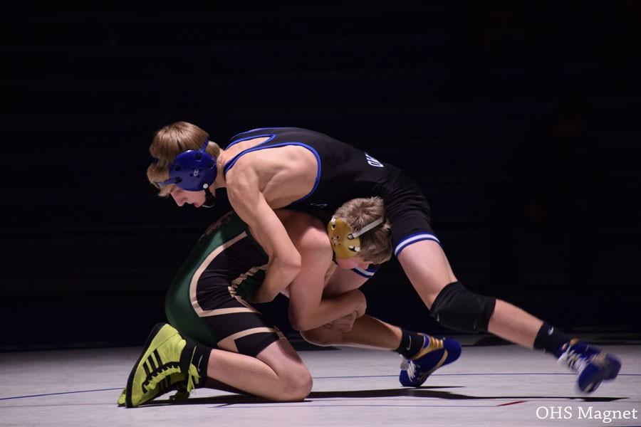 Freshman Riley Becker wrestling his opponent