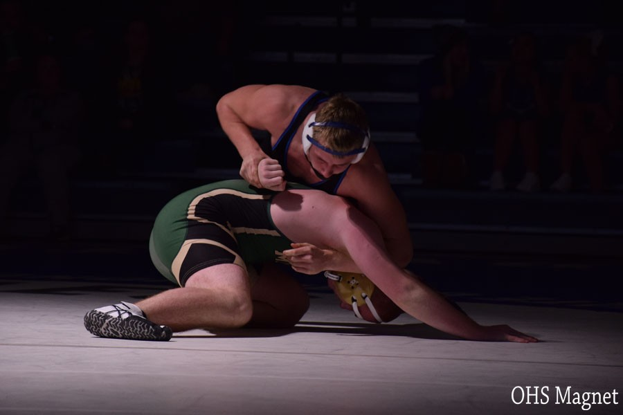 Junior Griffin Thorn wrestling his opponent