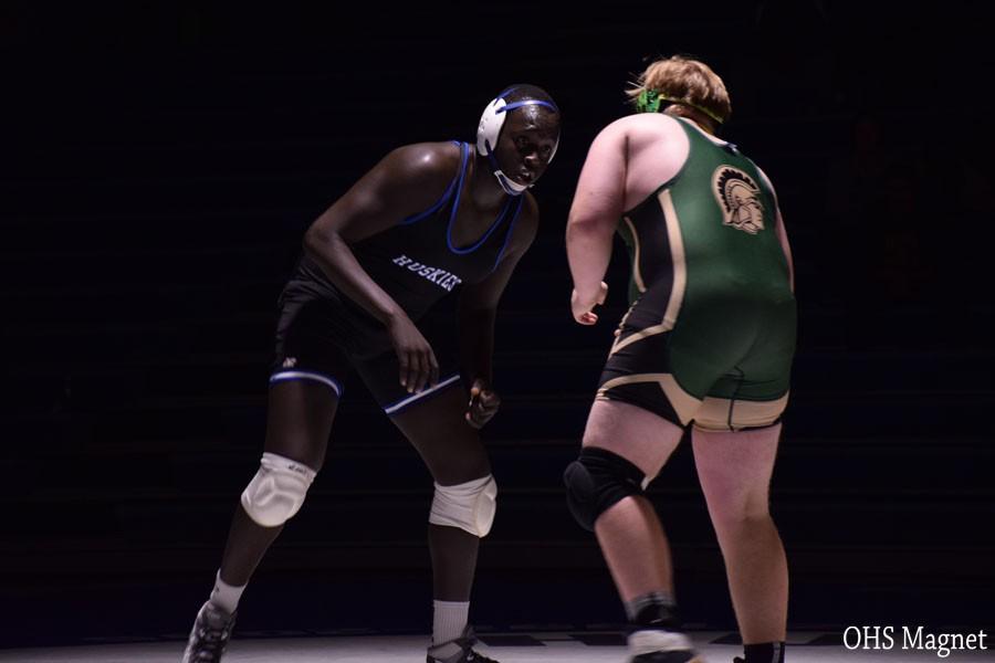 Junior Goy Tut wrestling his opponent