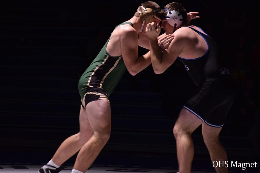 Senior Austin Abbas wrestling his opponent