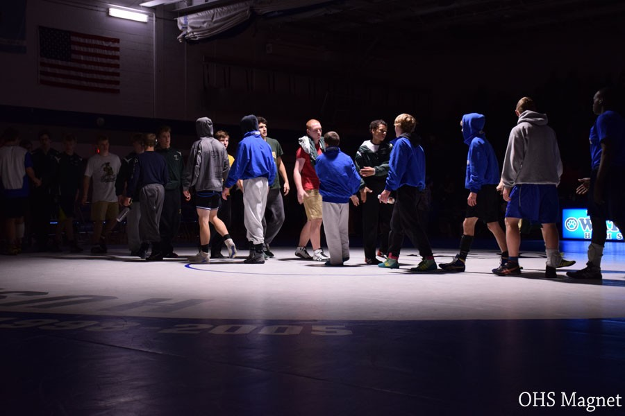 Teams shaking hands after the meet