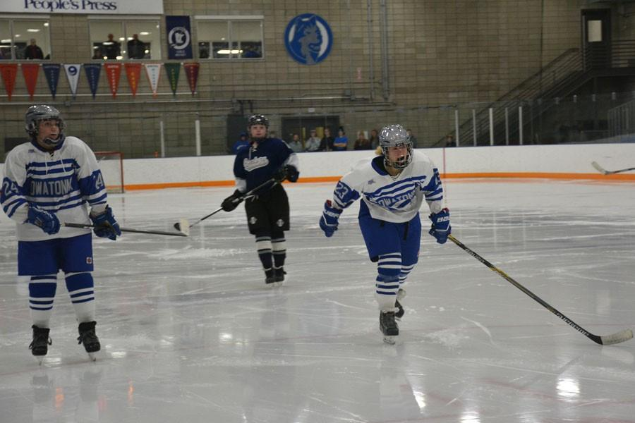 Sophomores Jamie Davison and Margo Acterkirch going for the puck