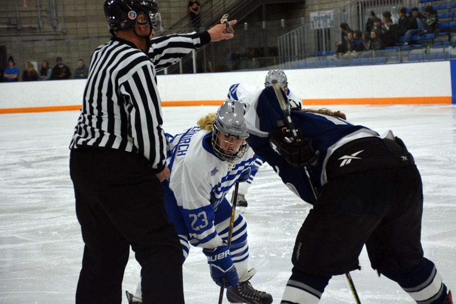Sophomore Margo Achterkirch facing off with a Century player