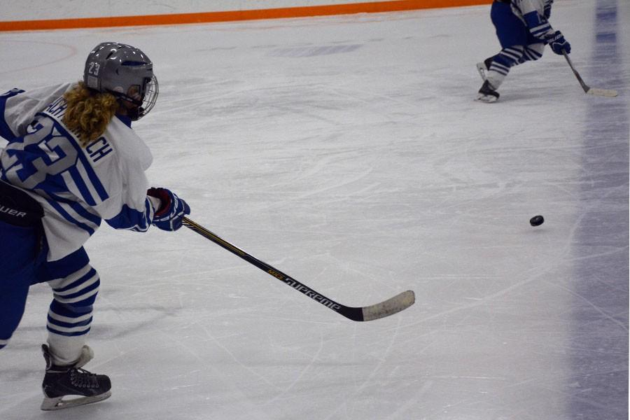 Sophomore Margo Achterkirch going for the puck