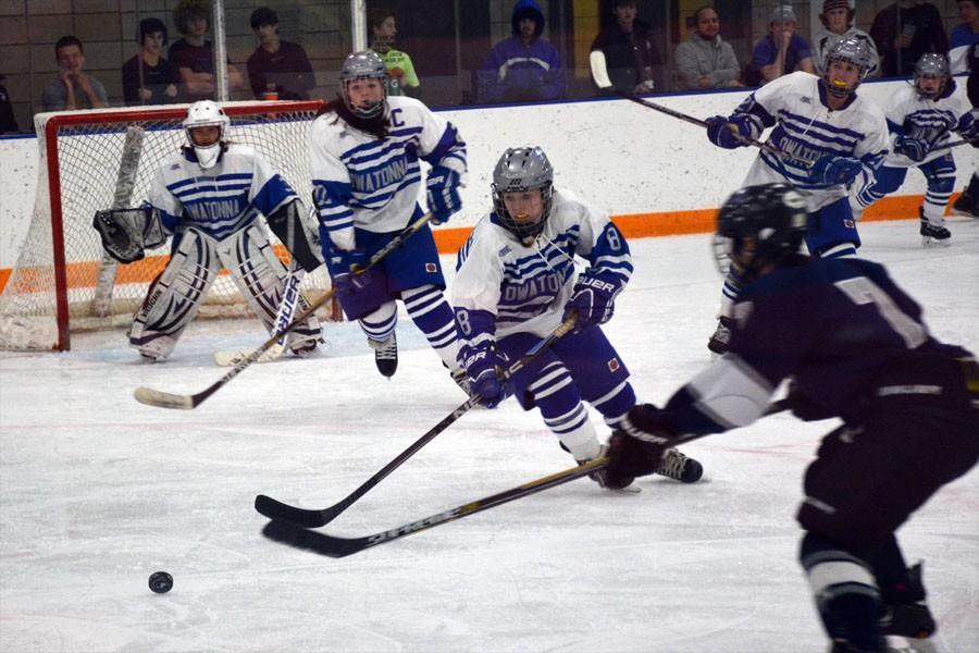 Owatonna Girls Hockey team defending the goal