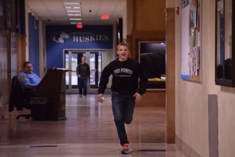 Sophomore Peyton Robb runs to the library as a winner of Ho Ho Bingo.