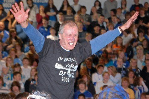 Mr. Dan Gaworecki at the 2009 Snow Week Pepfest being lifted up by the Teacher's Tug of War team