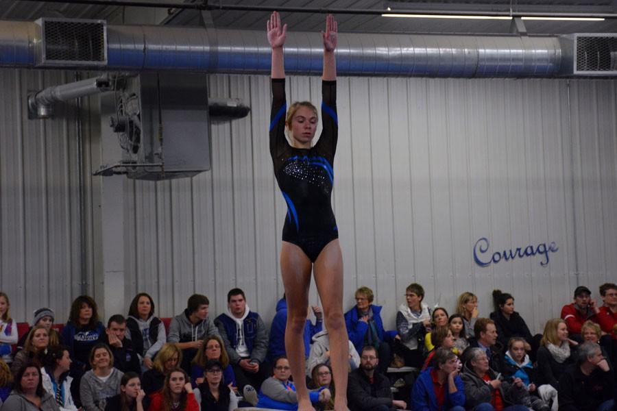 Freshman Sydney Kretlow doing her beam performance