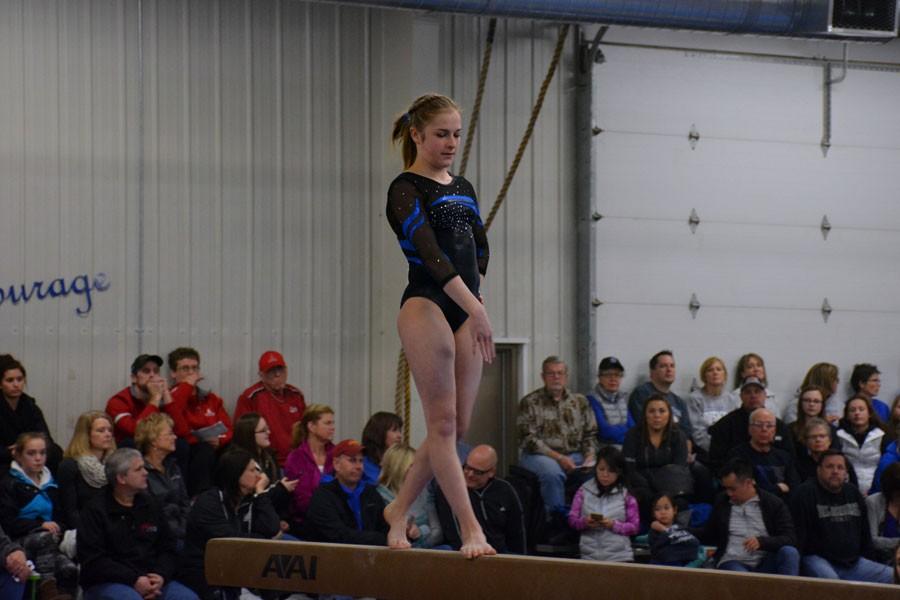 Sophomore Rebecca Olson doing her beam performance