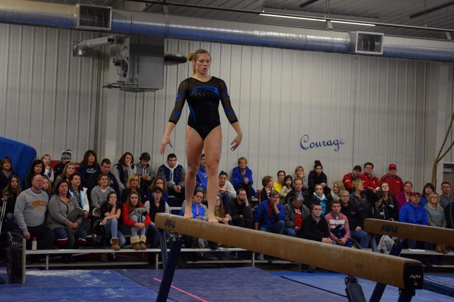 Senior Stephanie Kretlow doing her beam performance