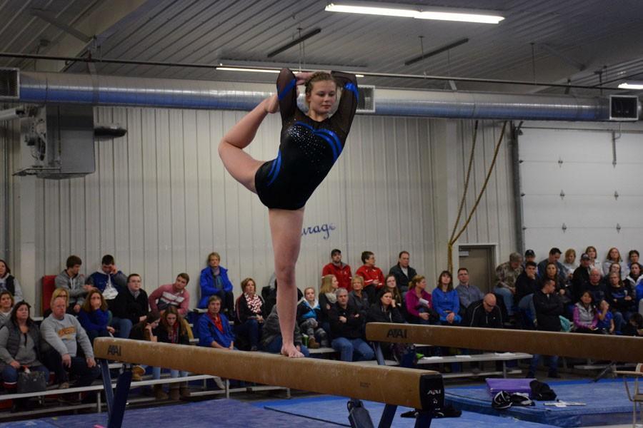 Sophomore Erica Svenby doing her beam performance