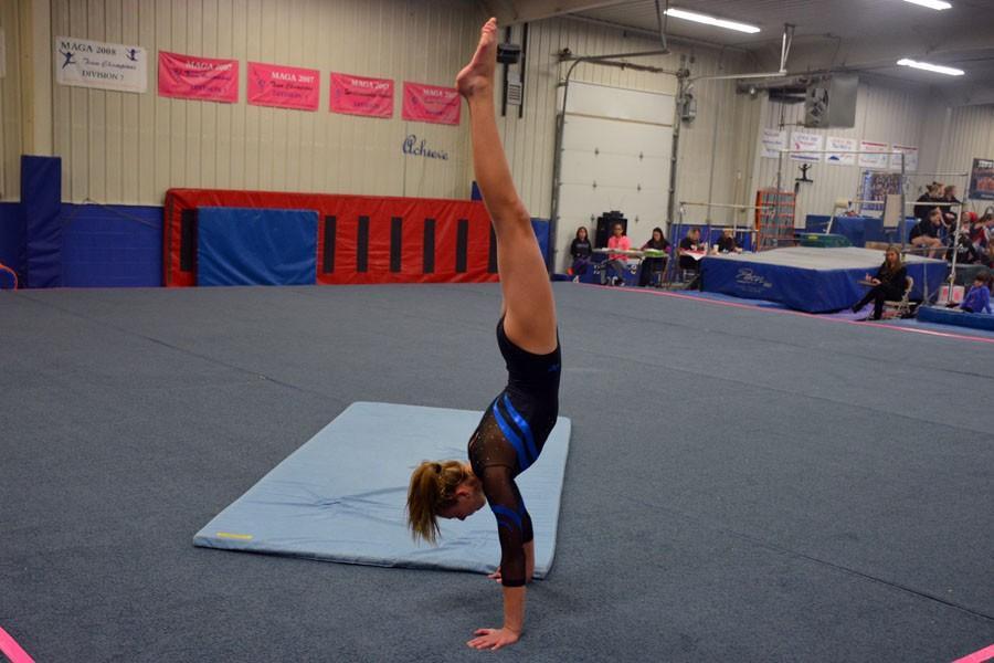 Freshman Sydney Kretlow doing her floor routine