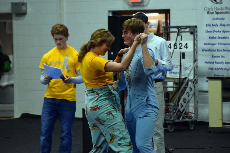 Senior Emma Smith and Sophomore Nick Sande dancing in the Snow Week Pepfest