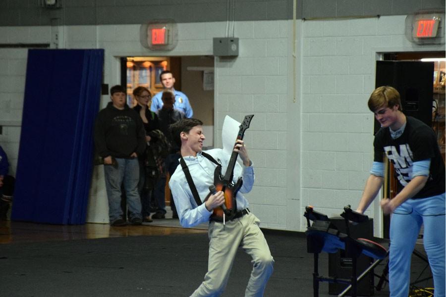 Sophomore Nick Hagen playing his Guitar in the Snow Week Pepfest