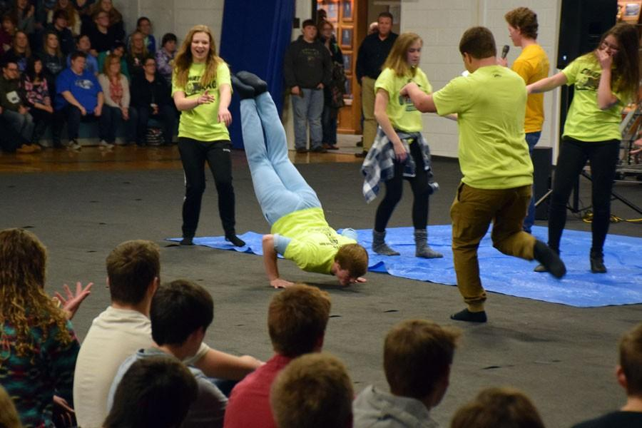 Owatonna student council dancing for Neon day for Snow Week