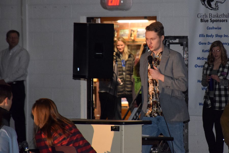 Senior Jackson Anderson performing his skit during the Snow Week Pepfest