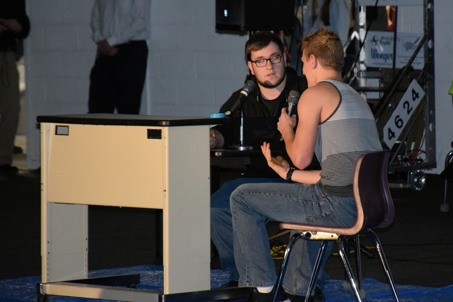 Senior Colton Heilman and Andrew Peterson performing their skit in the Snow Week Pepfest